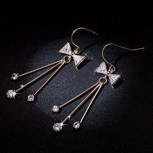 Jewelry - Gold & Crystal Bow Earrings w/Tassels